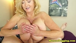 Chubby-mature-amateur-titfucks-cock-to-climax