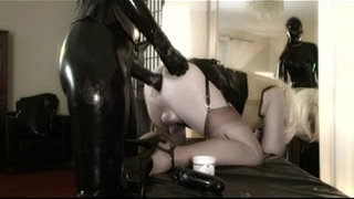 Sissy-slave-in-latex-got-fisted-by-latex-mistress
