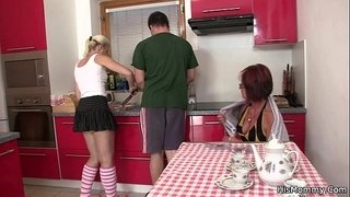 Future-mother-and-teen-toying-at-the-kitchen