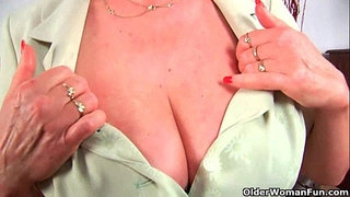 Grandma-in-stockings-massages-her-big-tits-and-old-pussy